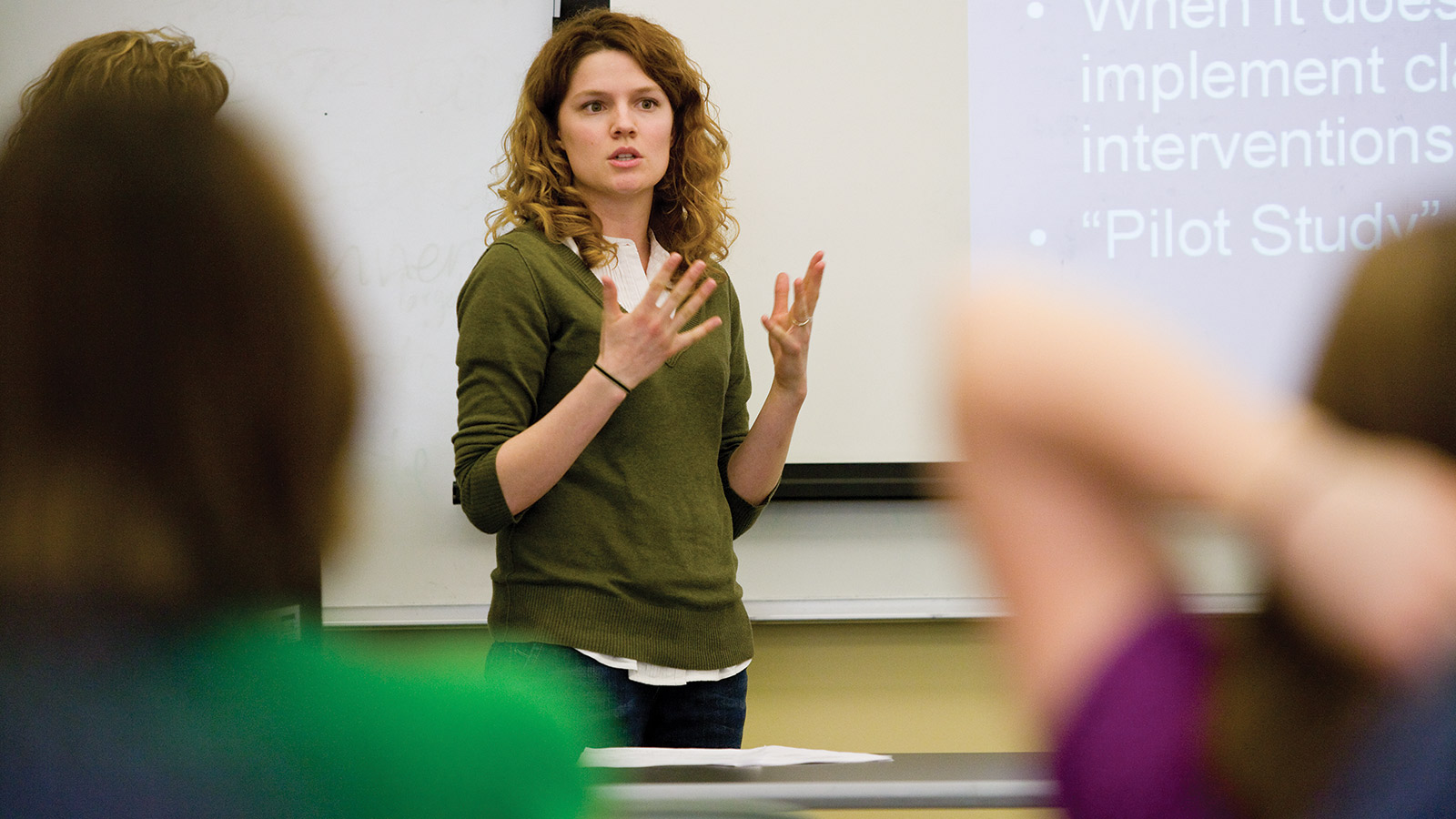 Photo of Communication Studies Member Engaged With Student